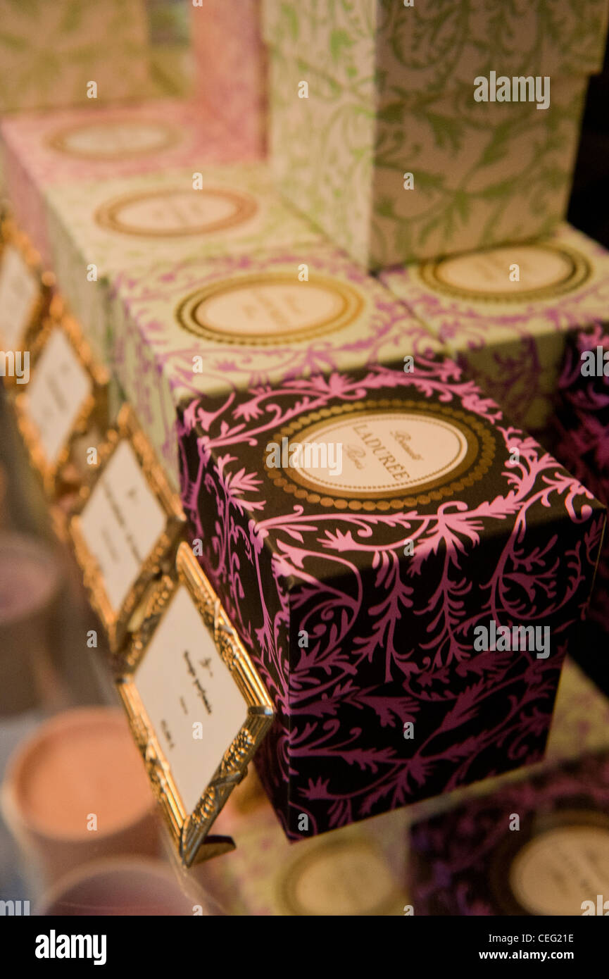Ladurée, one of Paris' most expensive bakery shops, also produces room perfumes and candles - Stock Image