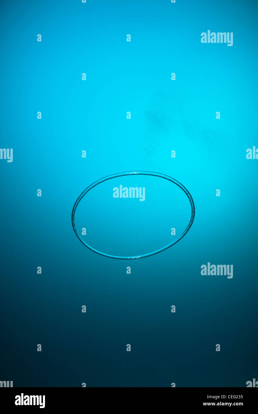 Underwater Bubble Ring made by Scuba Diver, Baa Atoll, Indian Ocean, Maldives - Stock Image