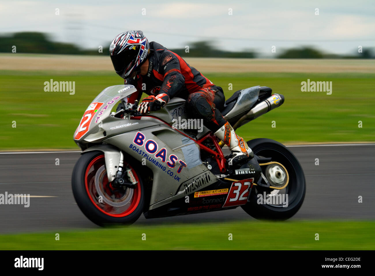 A photograph of a Ducati 848 racing at Castle Combe Circuit - Stock Image