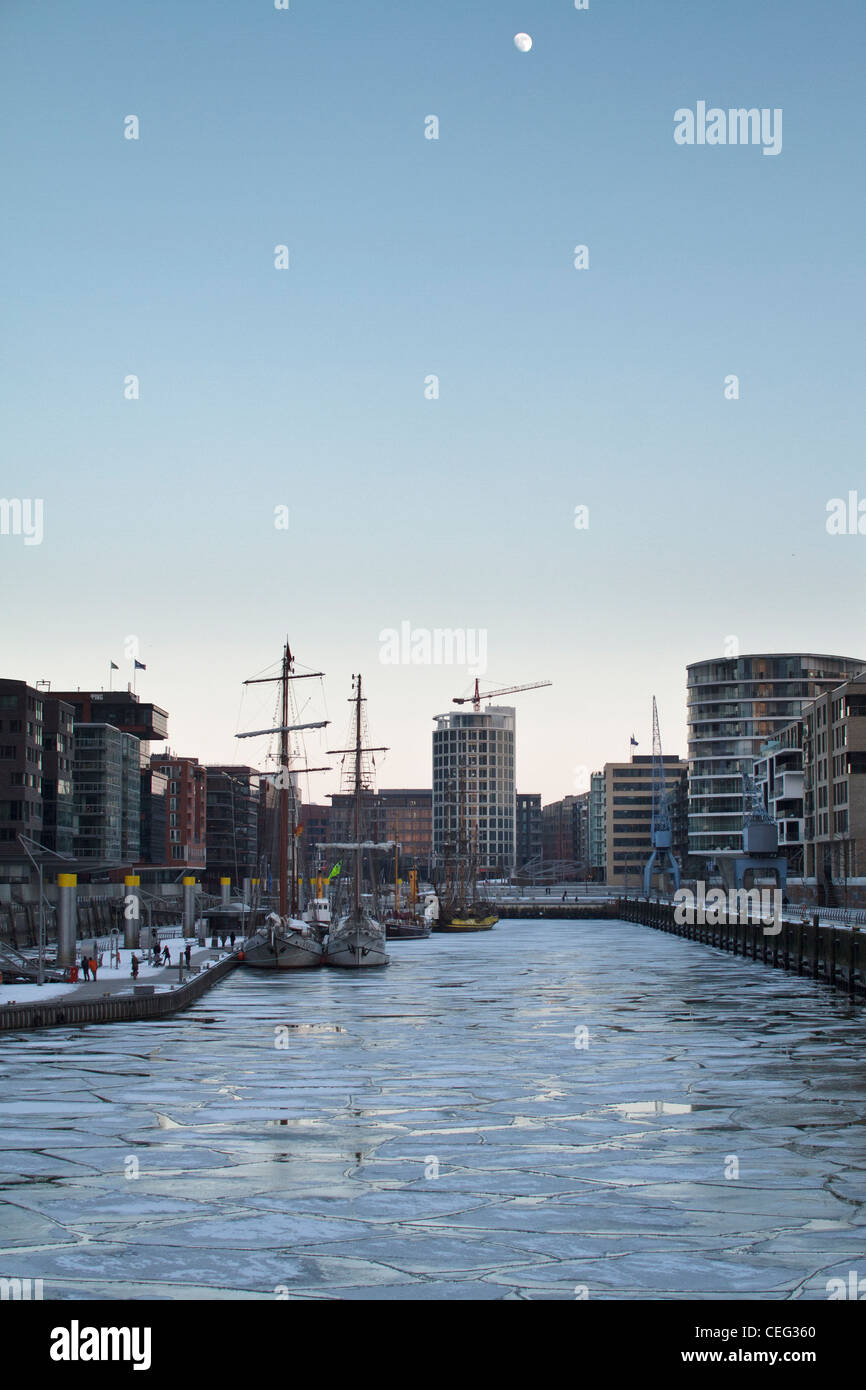 Shot of a very cold Hafen City in Hamburg where the canals have frozen - Stock Image