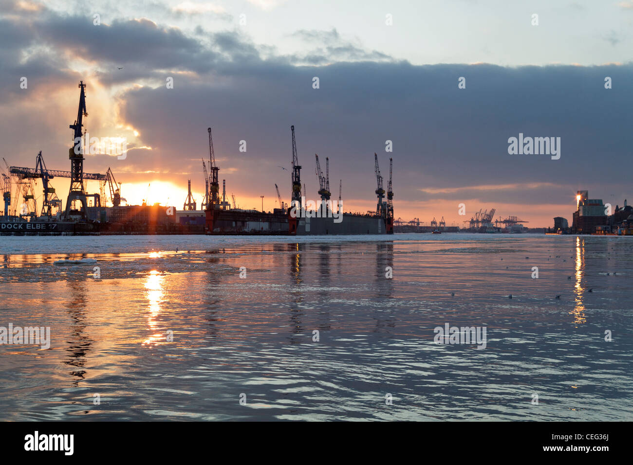 Looking West over the Elbe River in Hamburg as the sunsets - Stock Image