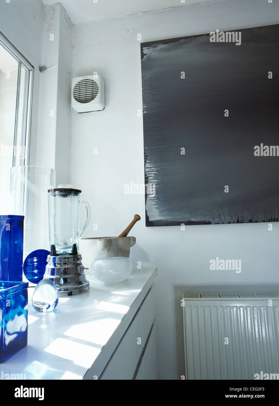 Electric Extractor Fan On Wall In Modern White Kitchen With Waring Stock Photo Alamy