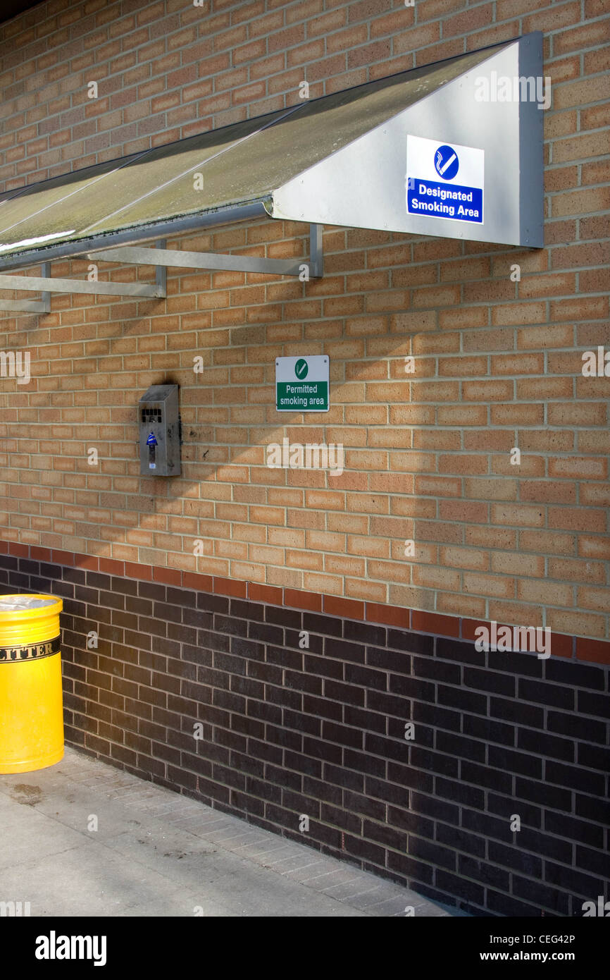 A covered Designated Smoking Area in a place of work - Stock Image