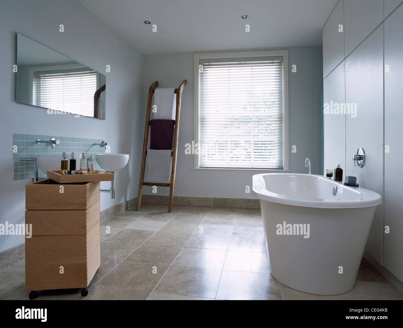Freestanding bath and movable storage unit with basin in modern ...