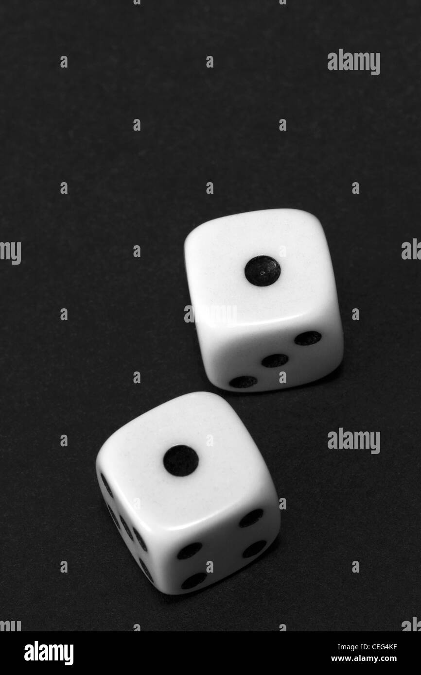 A black and white image of snake eyes rolled on a pair of dice - Stock Image