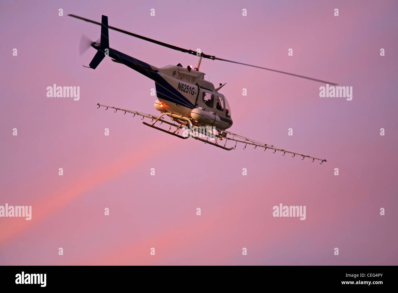 Holtville, California - A helicopter on a crop dusting flight in the Imperical Valley. - Stock Image