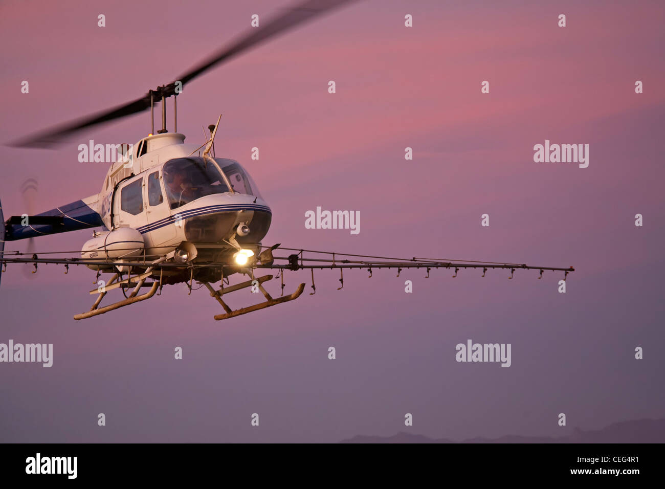 Holtville, California - A helicopter sprays a field in the Imperical Valley. Stock Photo