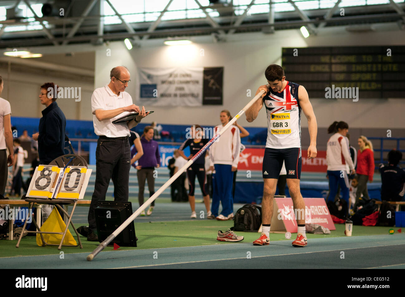 Athlete prepares for second attempt Pole Vault - Stock Image
