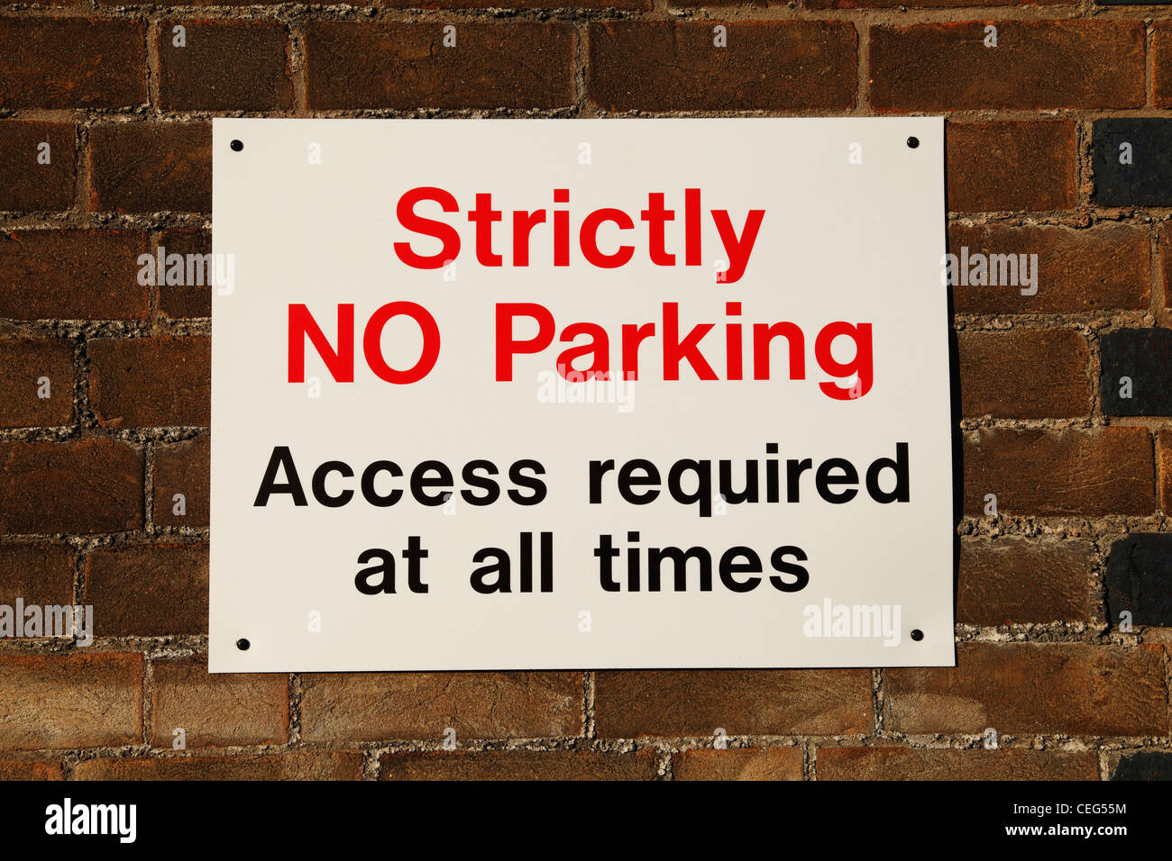 A no parking sign on a street in the U.K. - Stock Image