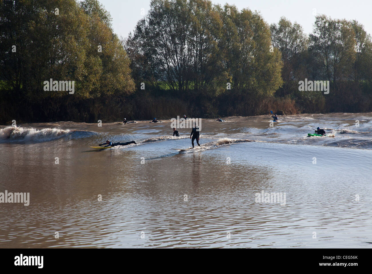 Surfers On The Severn Bore On The River Severn At