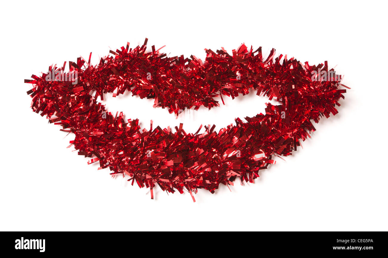 Lip Shaped Red Tinsel on a White Background. - Stock Image