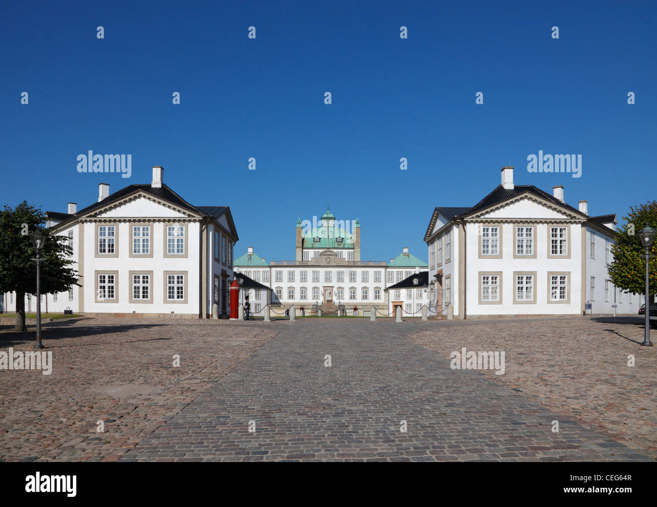 The Royal Fredensborg Palace in Fredensborg, near Copenhagen, Denmark. Bear skin sentries from The Royal Life Guards - Stock Image