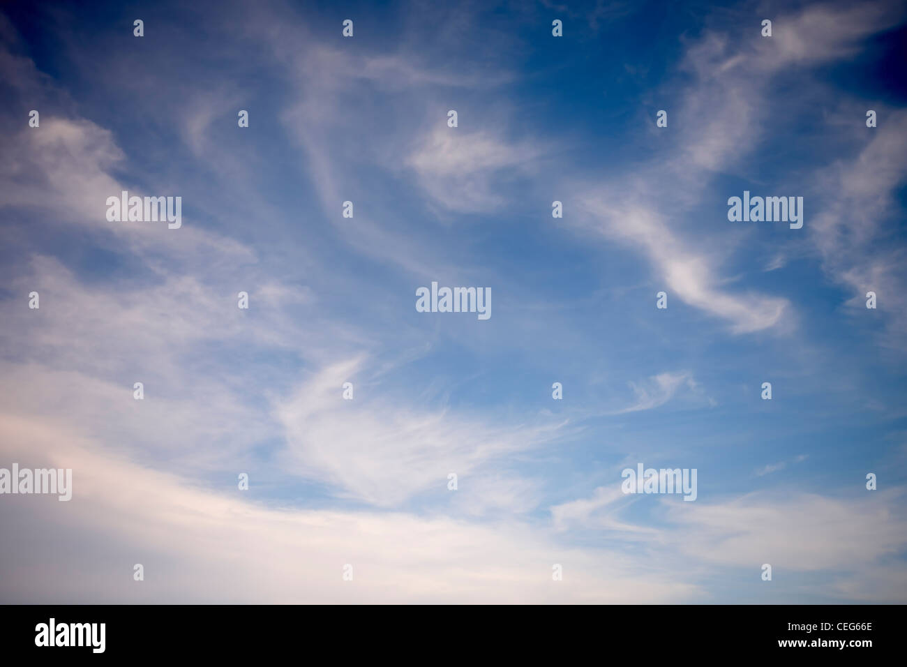 blue sky with wispy clouds - Stock Image