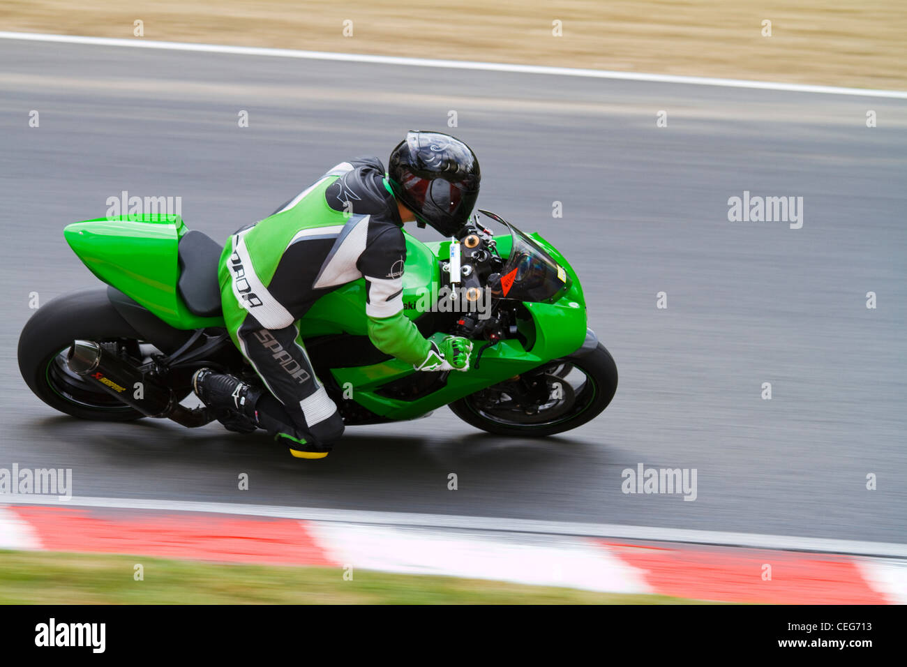 A photograph of a Kawasaki at a Brands Hatch Track day - Stock Image