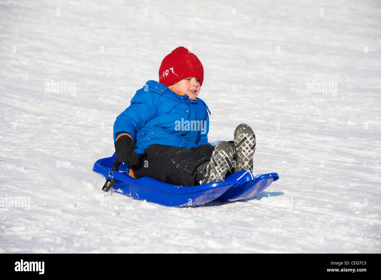 e607177e8 A child little boy sledding downhill winter Stock Photo: 43382979 ...