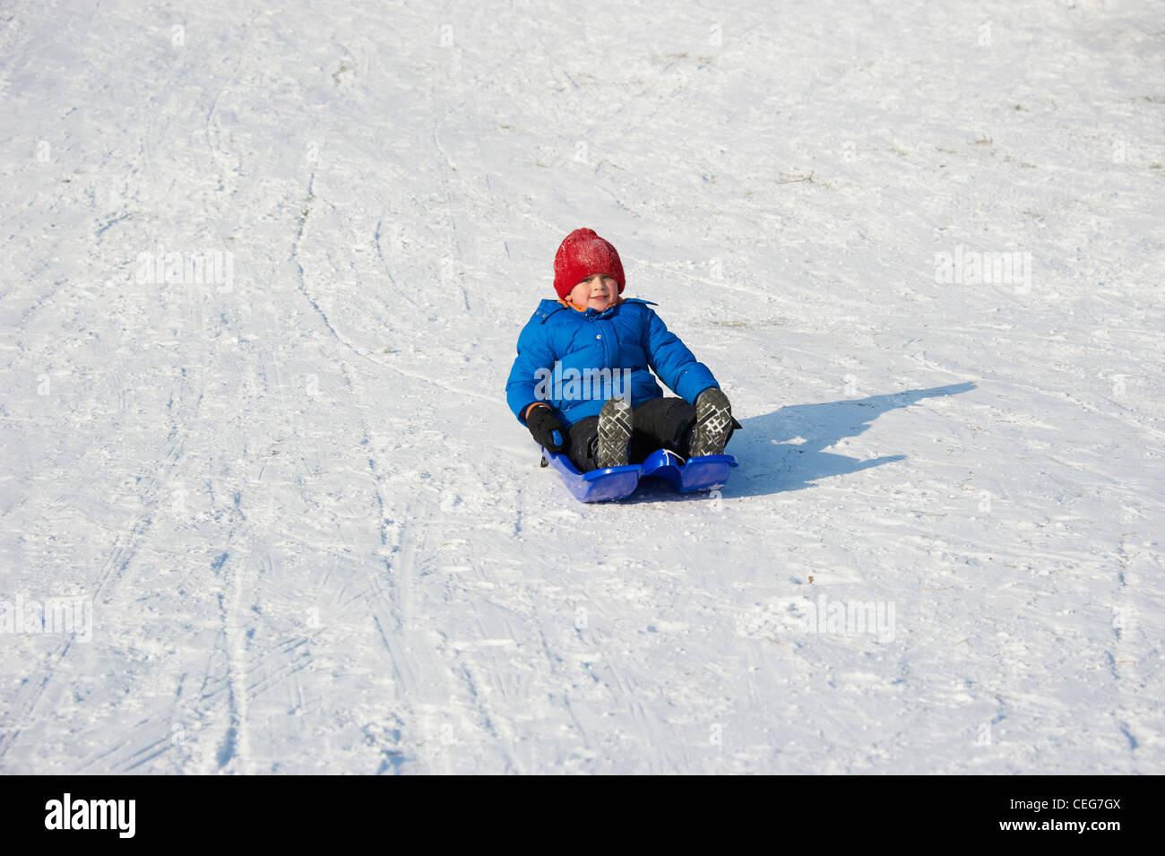 41206a663 A child little boy sledding downhill winter Stock Photo: 43383114 ...