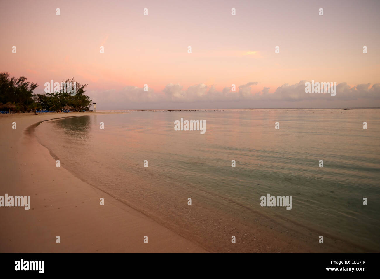 secluded Jamaican beach at sunrise - Stock Image
