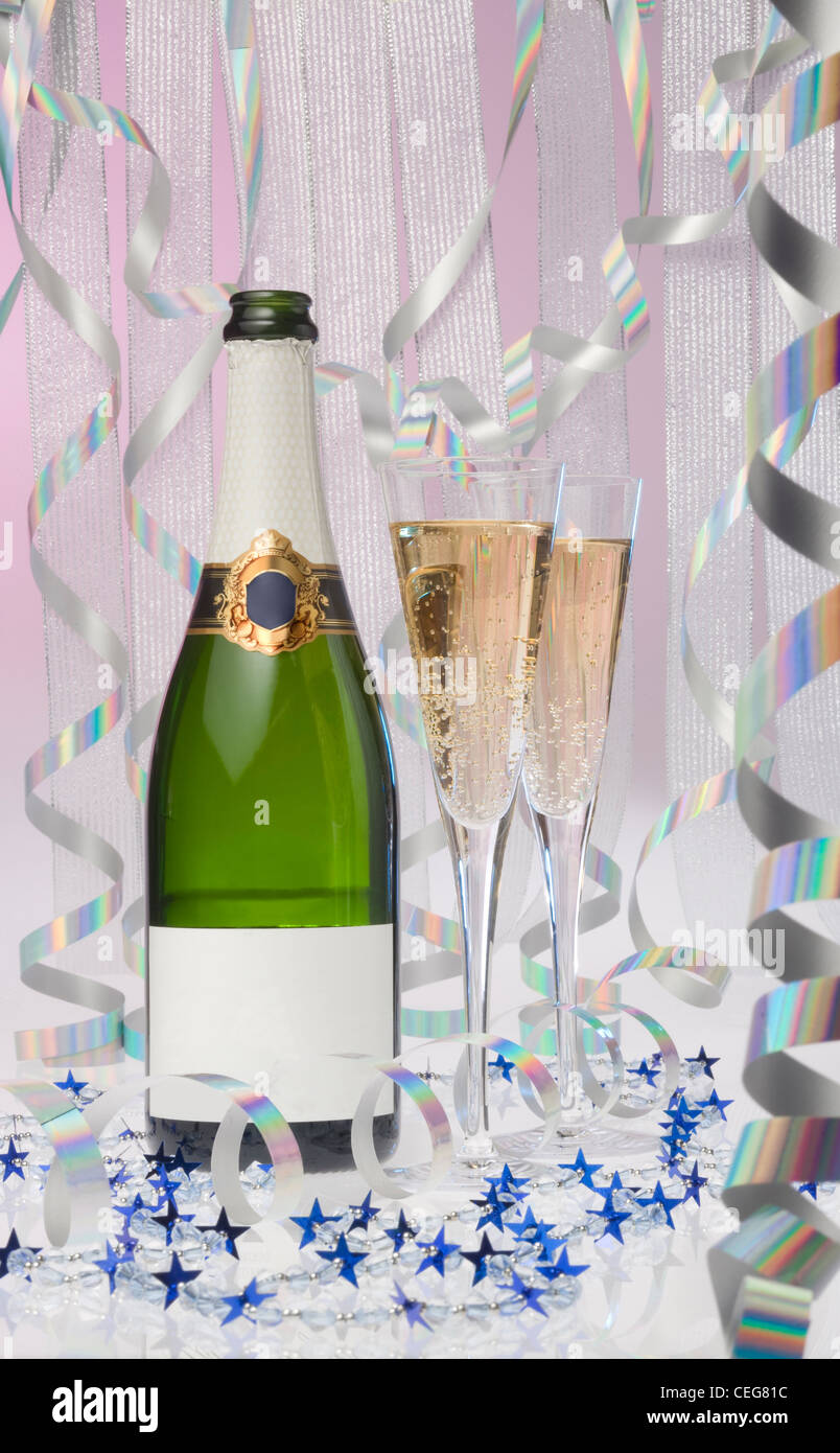Bottle of Champaign with two flutes and party decorations - Stock Image