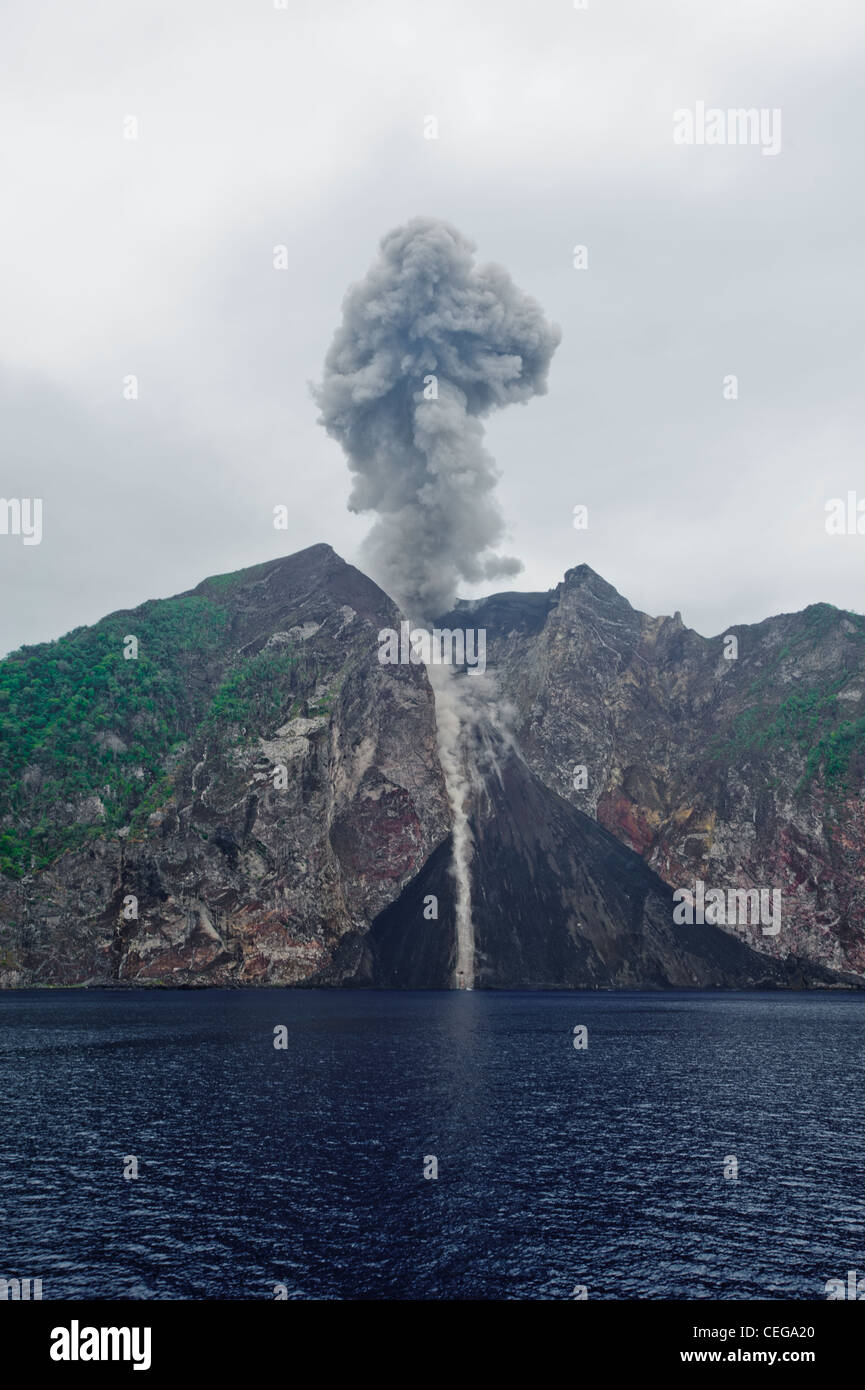 The Komba Volcano erupting, an island volcano in the middle of the sea at 100 miles from everything. Indonesia's - Stock Image