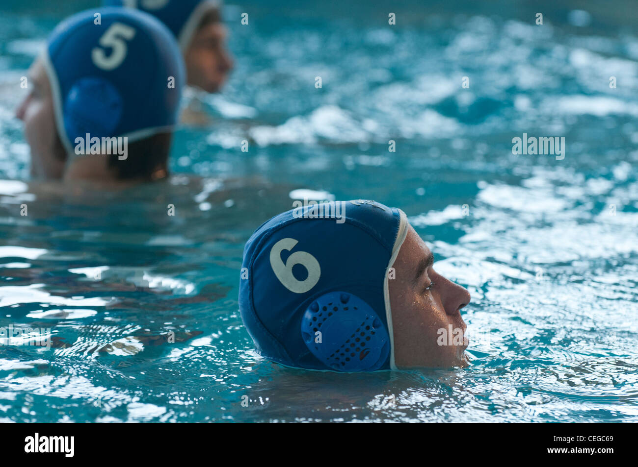 Amateur waterpolo match at the local swimming pool - Stock Image