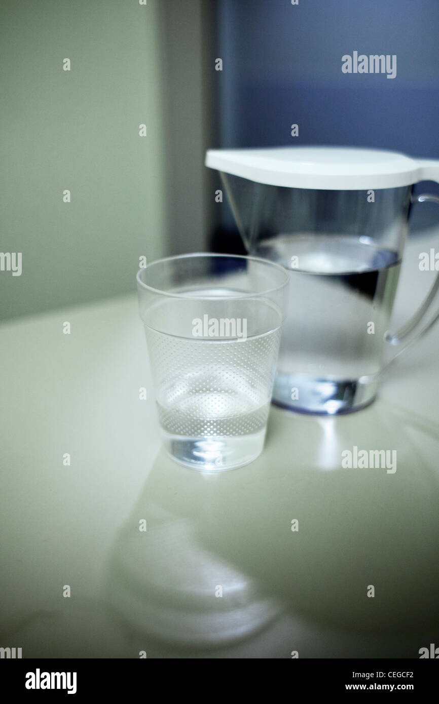 Drinking tapwater from a jug and beaker in hospital - Stock Image