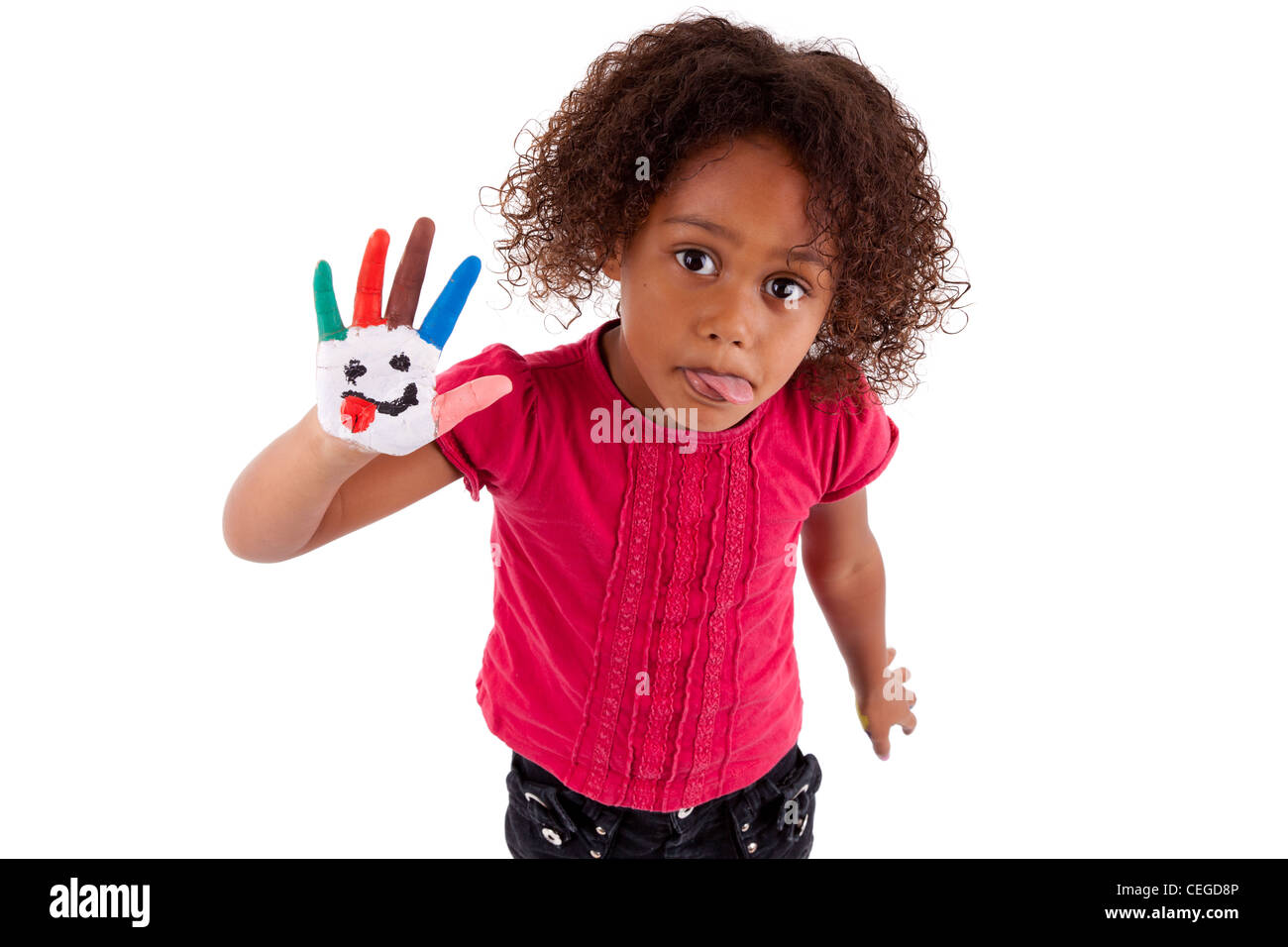 Little African Asian girl with painted hands in colorful paints - Stock Image