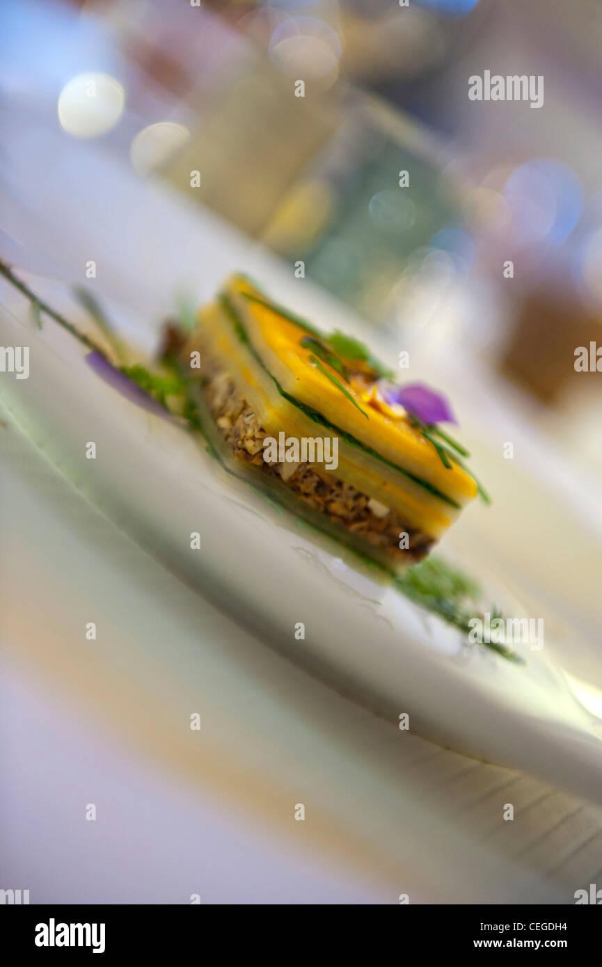 Vegetable millefeuille dish served at the Flocons de Sel restaurant,  Megève, France - Stock Image