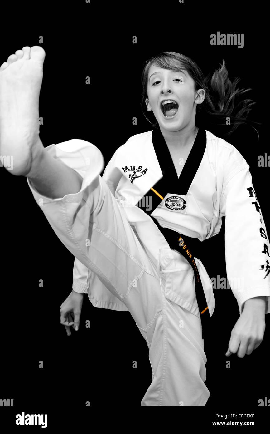 a young girl does a taekwondo axe kick Stock Photo: 43388674