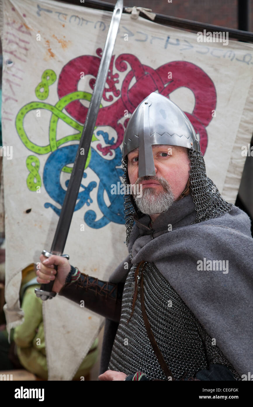 Viking re-enactor wearing helmet and carrying sword at the 27th Annual JORVIK Festival in York, UK Stock Photo