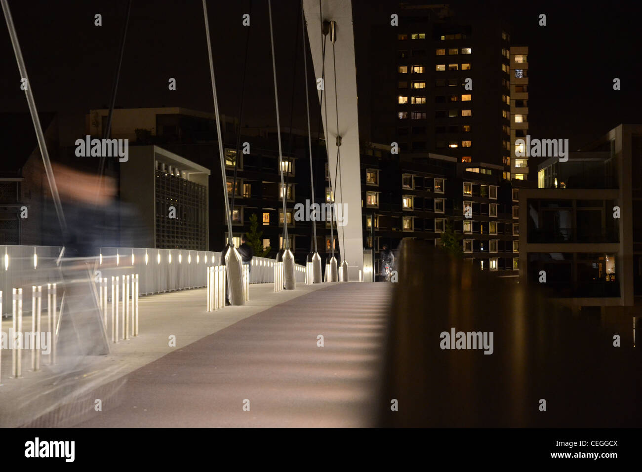 Hoge Brug in Maastricht, the Netherlands at night. Lights from the Ceramique in the background - Stock Image
