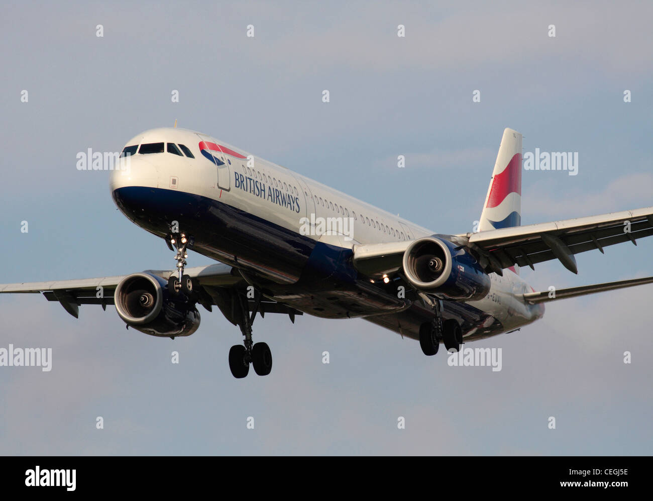 British Airways Airbus A321 passenger jet plane on approach. Close-up front view. - Stock Image