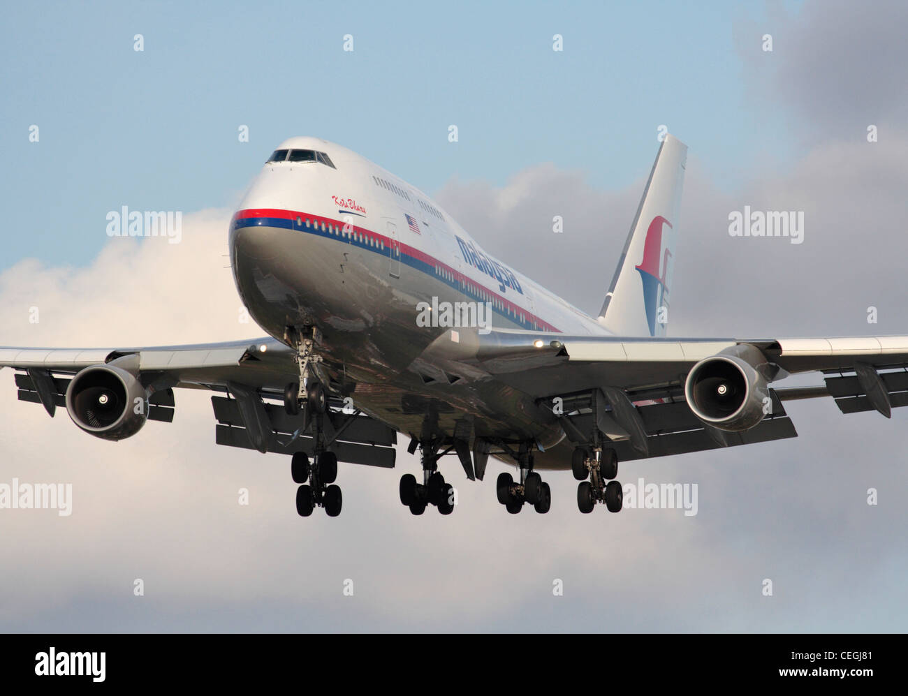 Malaysia Airlines Boeing 747-400 jumbo jet on arrival. Close up front view. - Stock Image