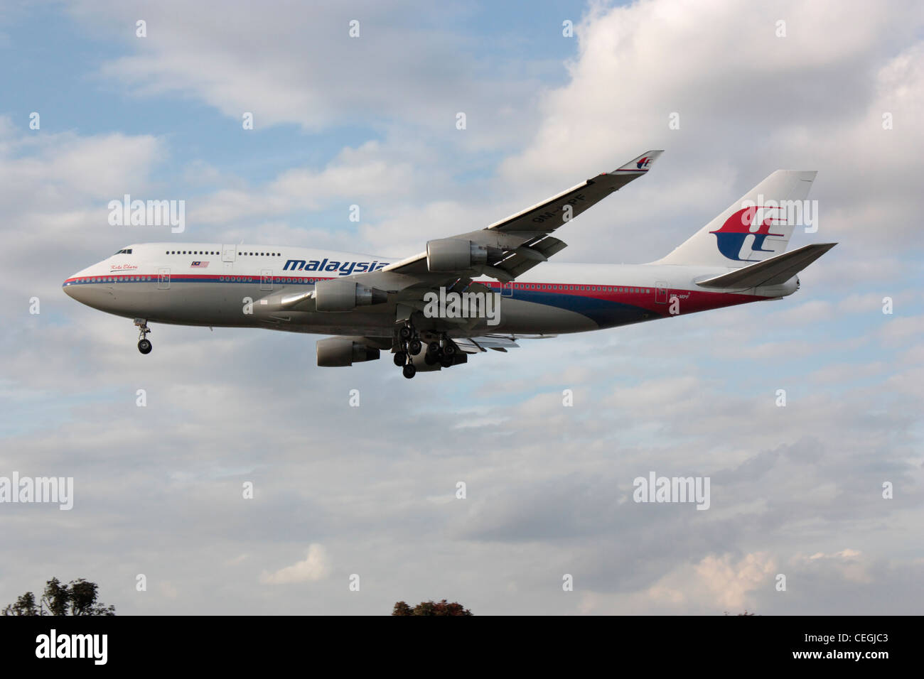 Malaysia Airlines Boeing 747-400 jumbo jet airliner on arrival at London Heathrow. Side view. Stock Photo