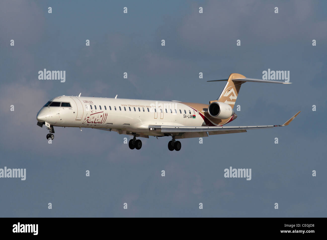 Libyan Airlines Bombardier CRJ900 with the post-revolutionary flag on the rear fuselage - Stock Image