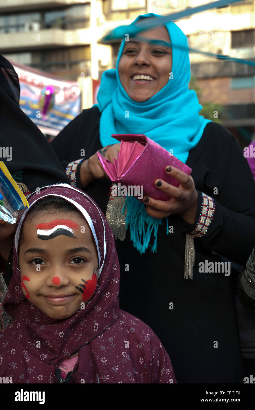 Young girl wears freshly-applied face paint in the national colours on the occasion of Eid el Adha celebrations - Stock Image