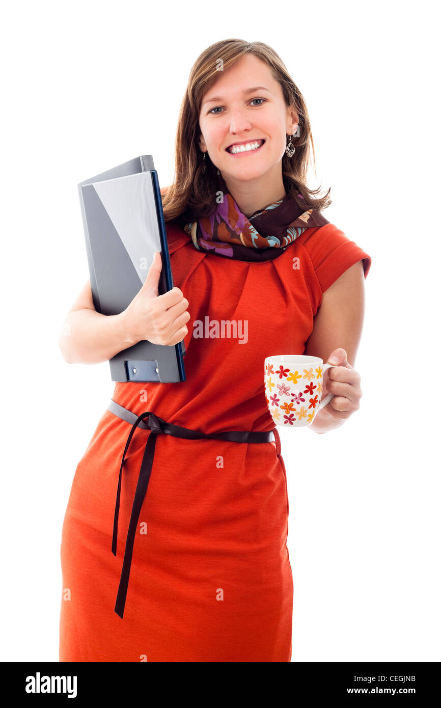Happy beautiful business woman holding files and mug, isolated on white background. - Stock Image