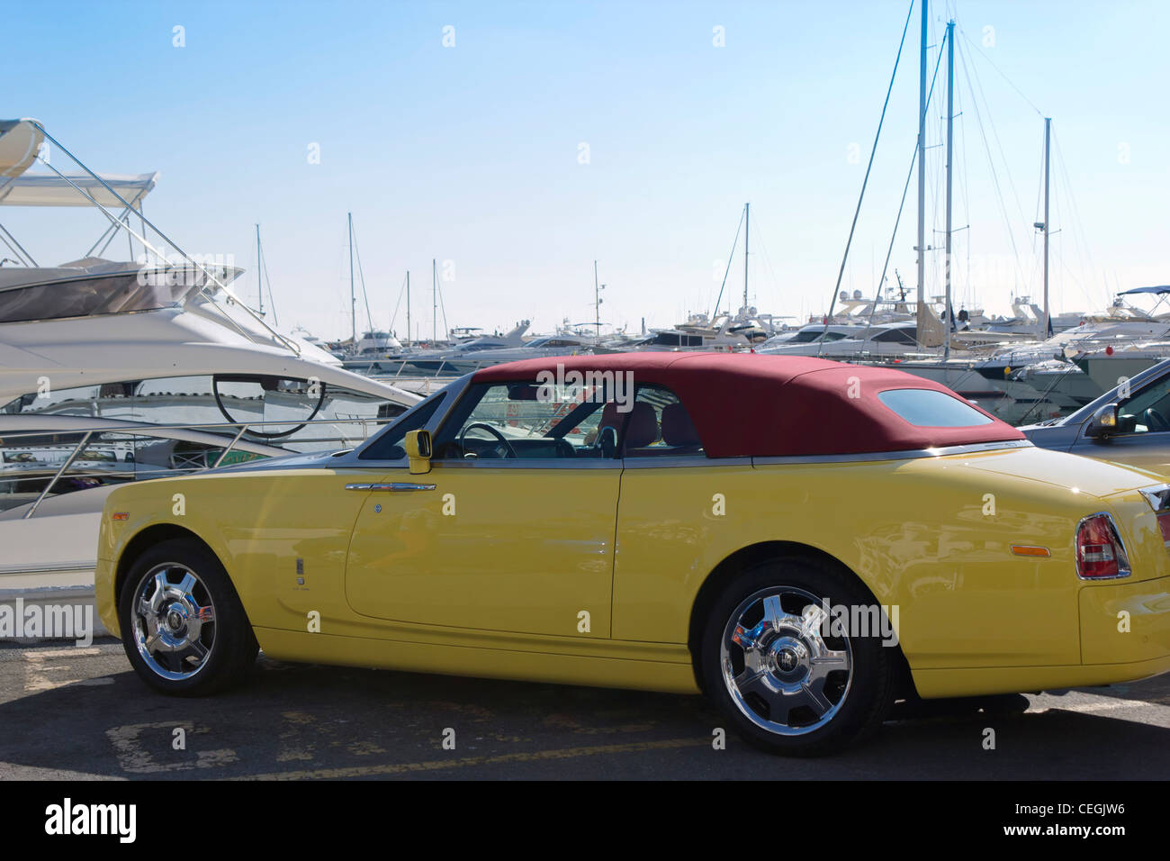 Yellow soft top convertible Rolls Royce parked in El Puerto José Banús, Marbella, Costa del Sol, Andalucia, - Stock Image
