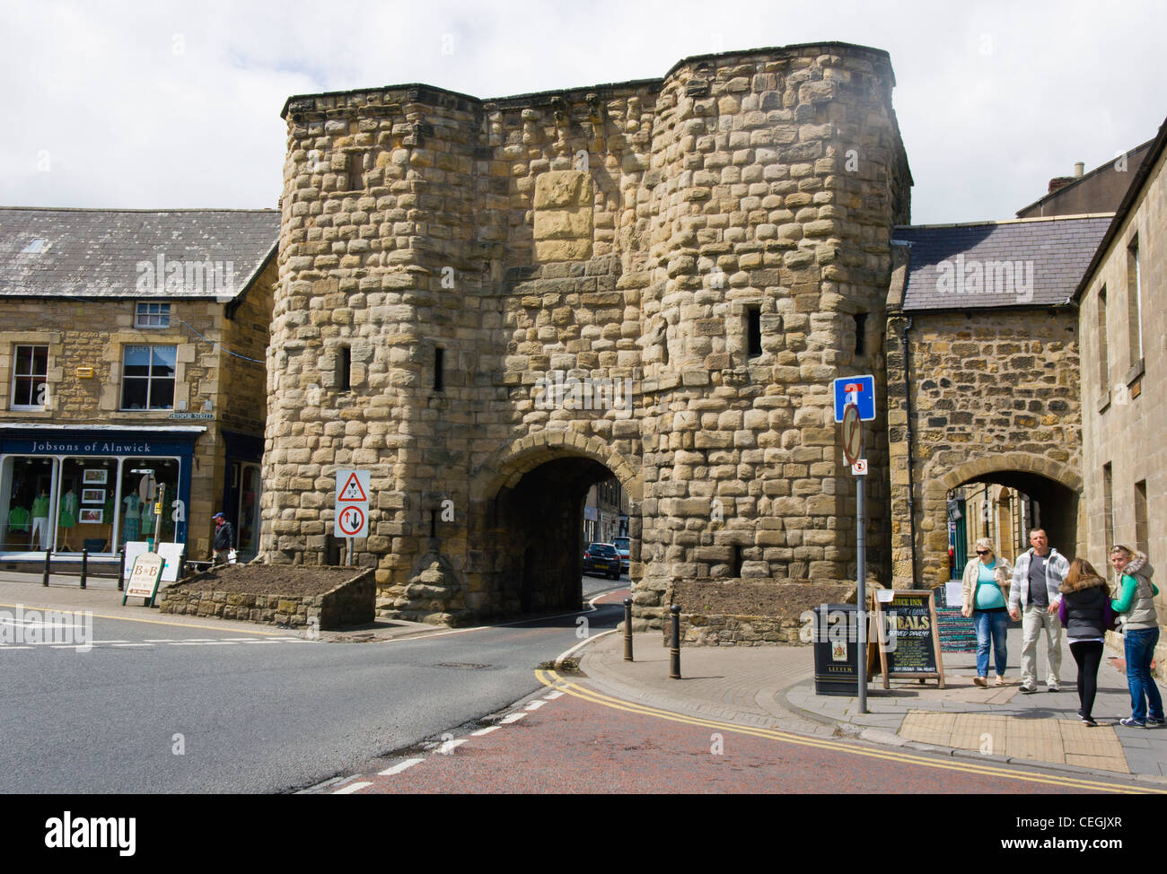 Alnwick, Northumberland, England. Entrance through the narrow arch of the Bondgate Tower, - Stock Image