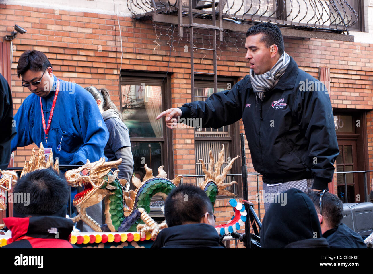 Cake Boss Buddy Valastro supervises the lifting of his cake onto a float for the 2012 Lunar New Year Parade in New - Stock Image