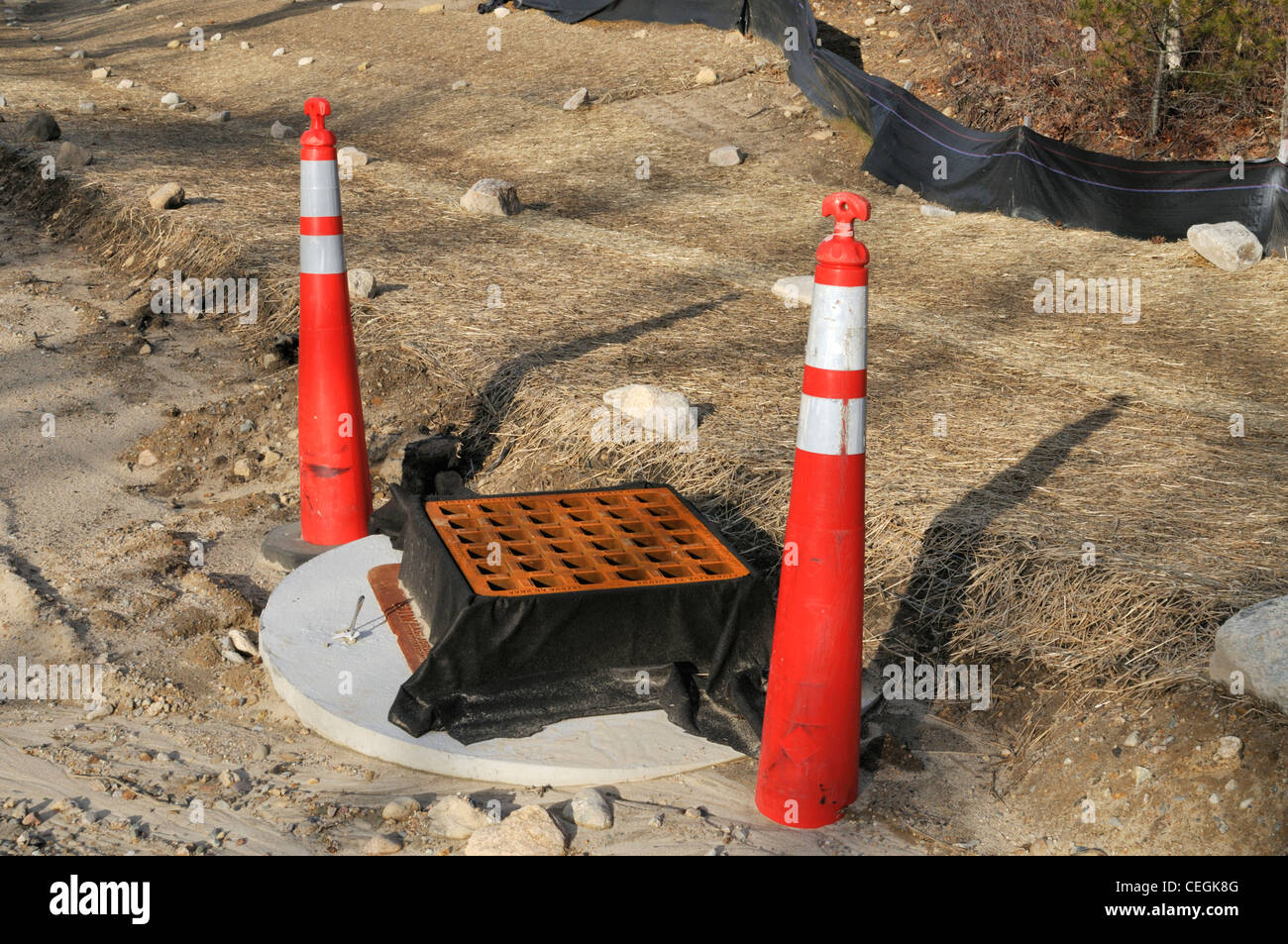 Storm drain runoff and erosion control along construction of a new road USA. - Stock Image