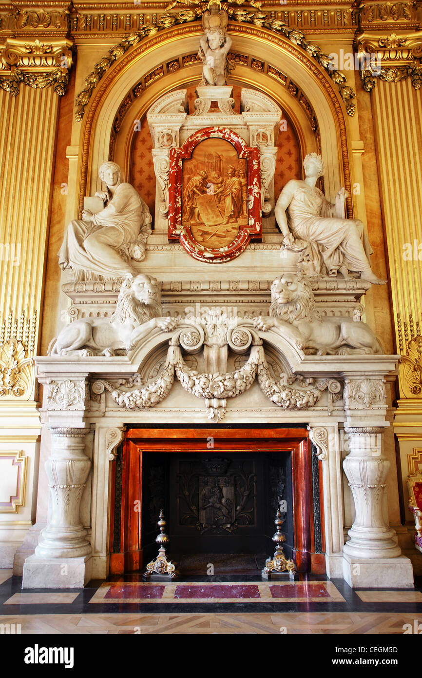 Magnificent marble fireplace with people and lions in european building, hotel de ville in Lyon France, rococo style. - Stock Image
