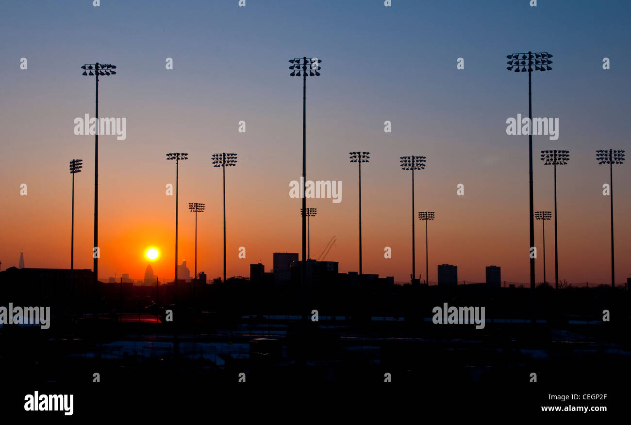 Olympic stadia light at sunset - Stock Image
