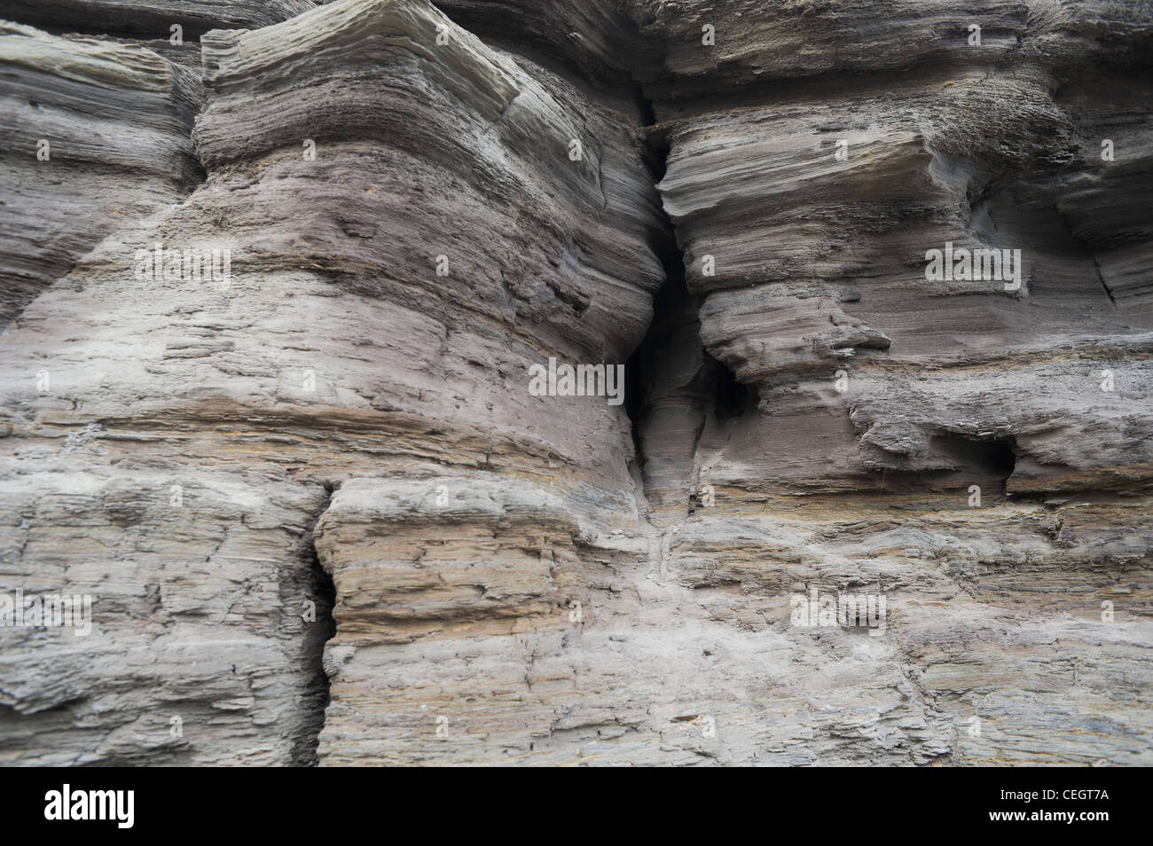 Rock formations along a coastal cliff face in Yorkshire, England. Stock Photo