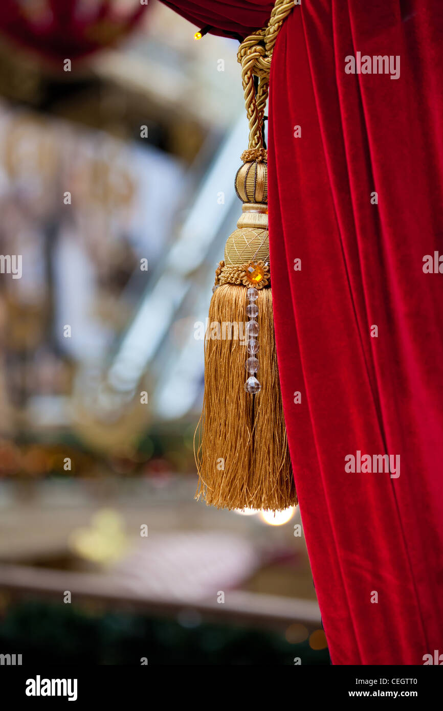 Red curtain open and tied the gold cord - Stock Image