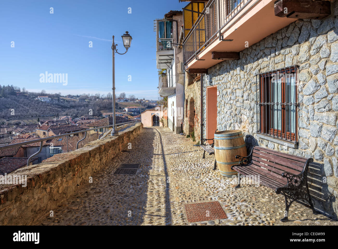 Narrow stone paved street and old houses in town of La Morra, Northern Italy. - Stock Image