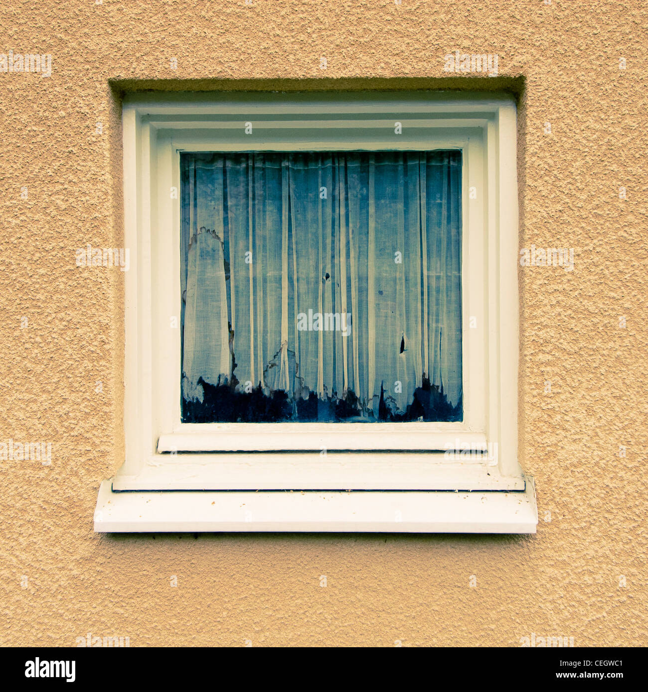 Window with old and dirty curtain - Stock Image