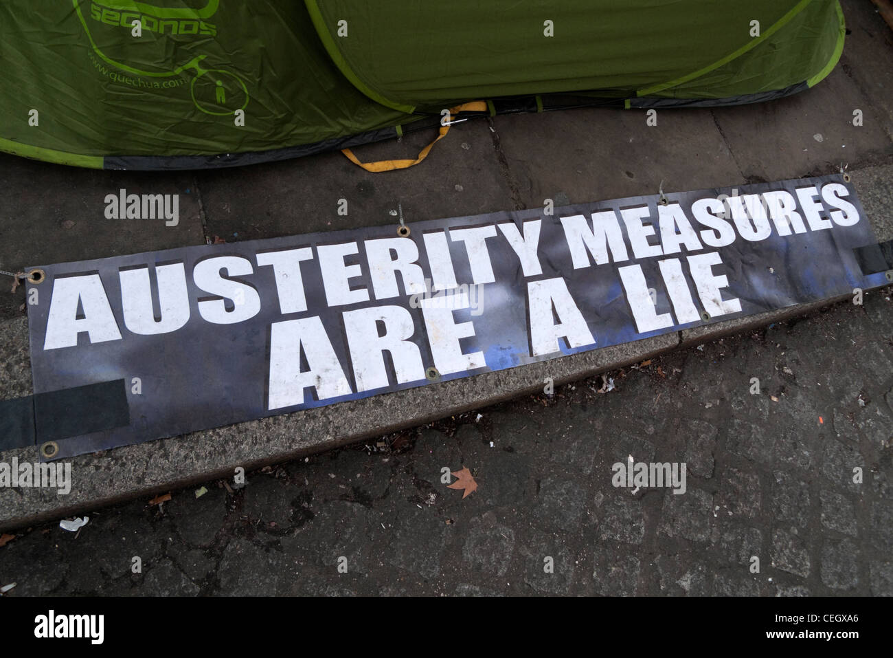 A sign declaring 'Austerity Measures Are A Lie' by protesters protestors on the pavement at the St. Paul's - Stock Image