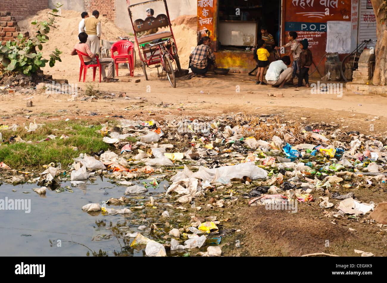 Rubbish in the overspill sewage, Vrindavan, Uttar Pradesh, India - Stock Image