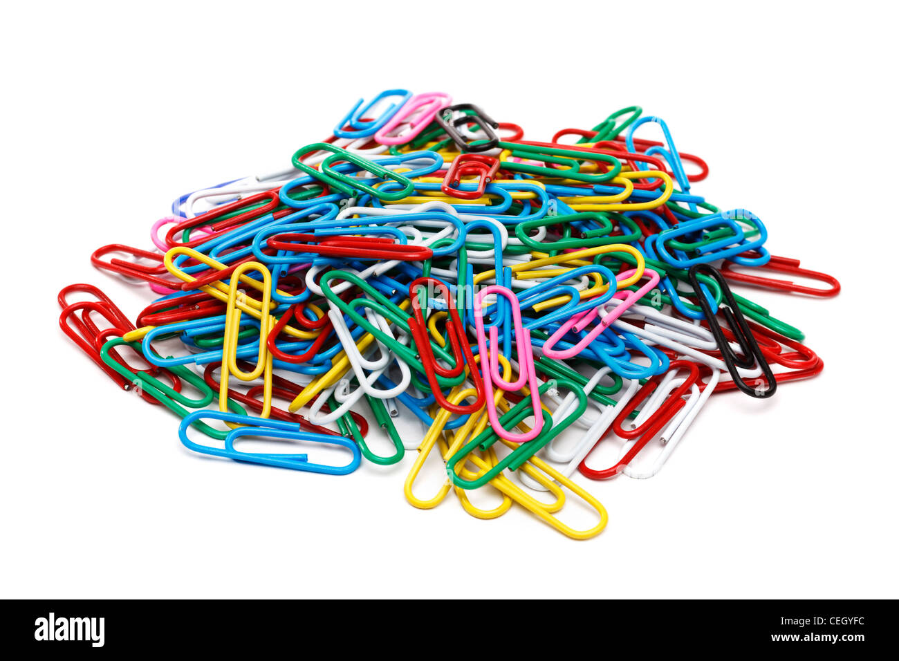 Pile of paper clips on white background - Stock Image