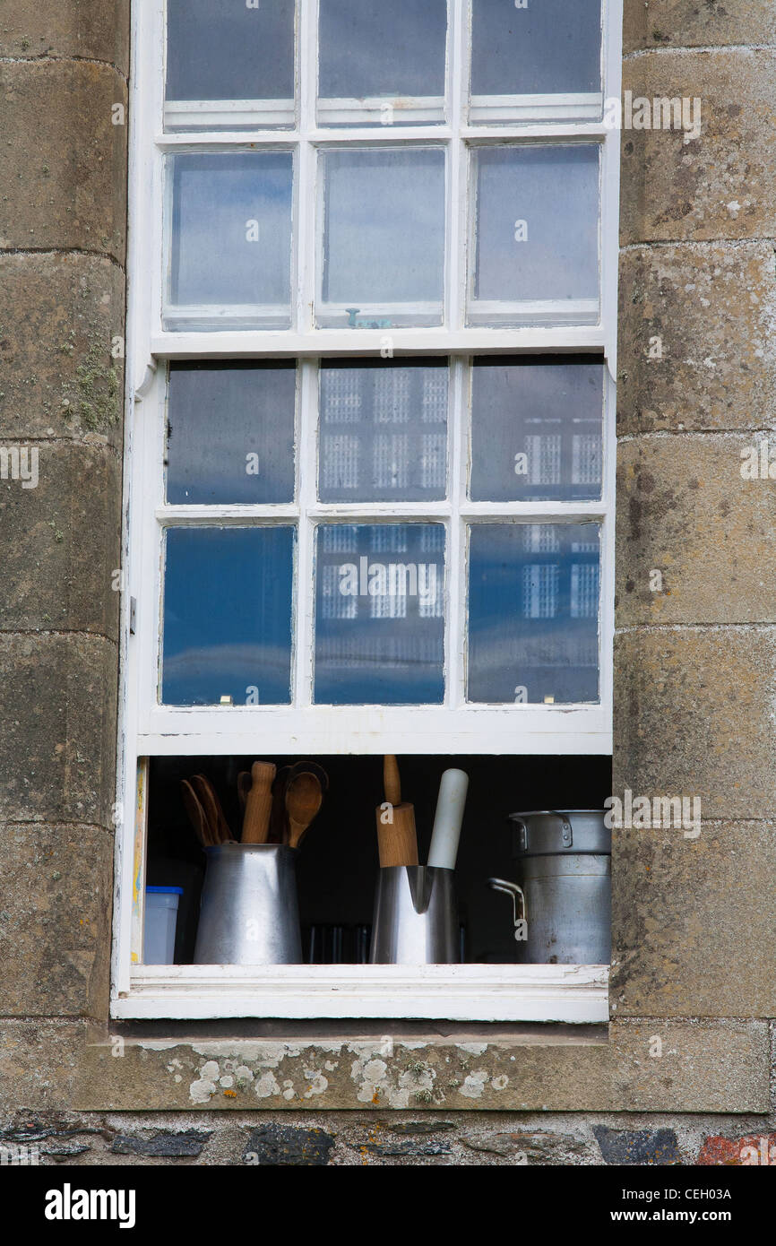 Old kitchen implements by an open window on the isle of Iona close ...